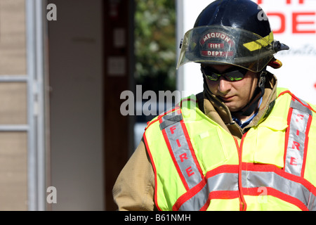 A Mequon Fire Department firefighter member looking down at a scene Wisconsin - Stock Photo