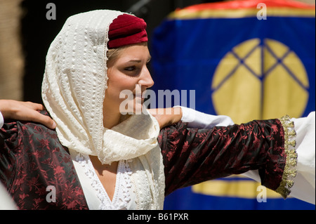 Woman dancing a traditional dance in traditional costume. - Stock Photo