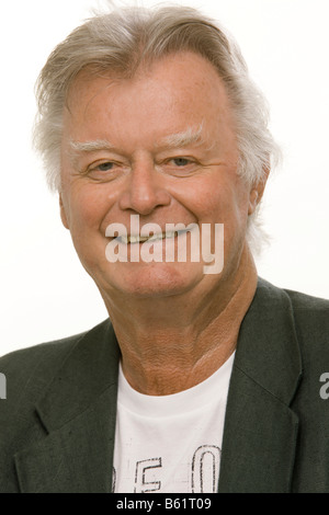 Man, 70, looking in the camera, portrait - Stock Photo