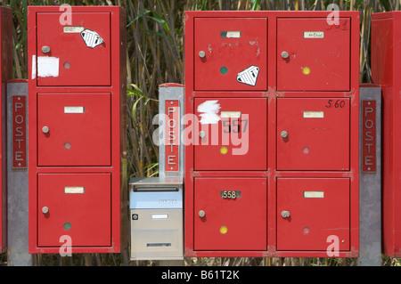 Red mailboxes on a road near Cugnana, Sardinia, Italy, Europe - Stock Photo