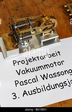 Small vacuum motor, apprentice project work exhibition, work-shop in the Max-Planck-Institute for radio astronomy, - Stock Photo