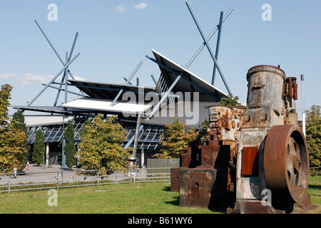Rusty machine part from an iron and steel works, open-air area of the Rhine Industrial Museum, bus and railway station - Stock Photo