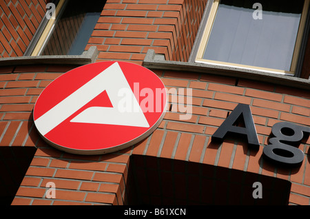 Symbol of the German Federal Employment Agency on the facade of a building, Berlin, Germany, Europe - Stock Photo