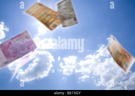 Euro bank notes falling from the sky - Stock Photo