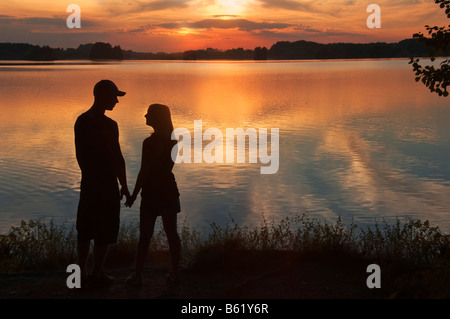 Young lovers at sunset by the Seehamer Lake, Upper Bavaria, Germany, Europe - Stock Photo
