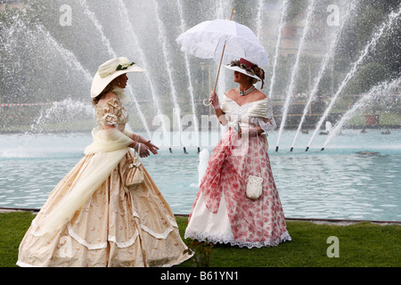 Two women wearing historical costumes in front of a fountain, Rákóczi-Fest festival, Bad Kissingen, Rhoen, Lower - Stock Photo