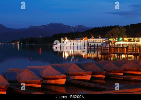 Night-time illuminated harbour in Prien, Chiemsee lake, Chiemgau, Upper Bavaria, Germany, Europe - Stock Photo