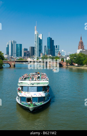 Tourist ship on the Main River, skyline of Frankfurt, Hesse, Germany, Europe - Stock Photo