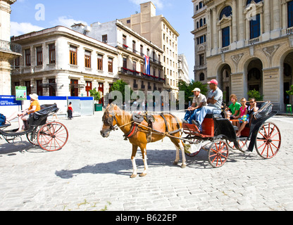 Horse and carriage for tourists in the historic city centre of Havana, Cuba, Caribbean - Stock Photo