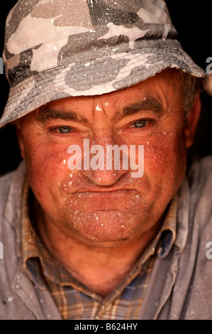 Portait of a farmer with paint flecks on his face, Eckental, Middle Franconia, Bavaria, Germany, Europe - Stock Photo