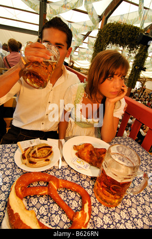 Oktoberfest Beer Festival, Wies'n, couple in a beer tent, Munich, Bavaria, Germany, Europe - Stock Photo