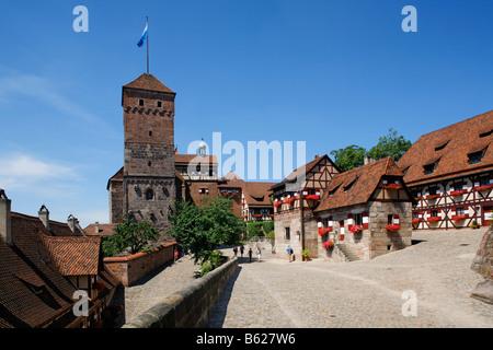 Nuremberg Castle or Kaiserburg, fore-court, Heidenturm Tower, deep well, half-timbered houses, historic city centre, - Stock Photo