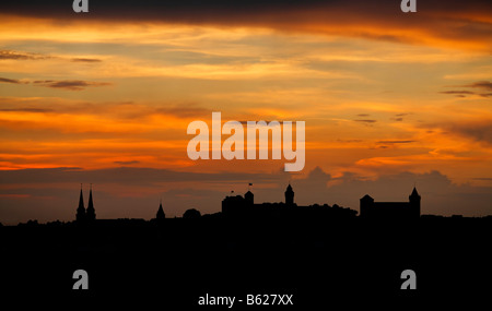 Red evening sky with the silhouette of the historic city centre, Nuremberg, Middle Franconia, Bavaria, Germany, - Stock Photo