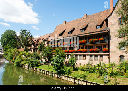 Pegnitz River, house decorated with flowers in the Heilig Geist Spital, historic city centre, Nuremberg, Middle - Stock Photo