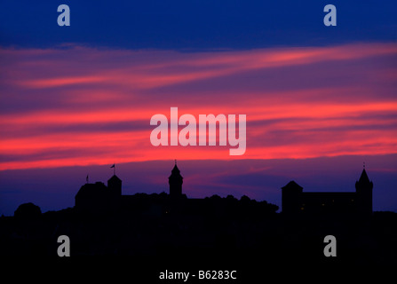 Nuremberg Castle or Kaiserburg, silhouette, red evening sky, historic city centre, Nuremberg, Middle Franconia, - Stock Photo