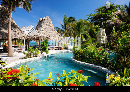 Hotel swimming pool with views onto the ocean, San Pedro, Ambergris Cay Island, Belize, Central America, Caribbean - Stock Photo