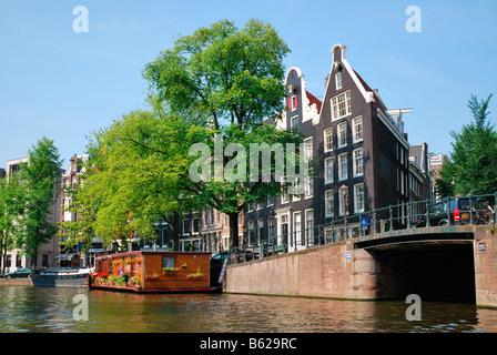 Houseboat beside a bridge, Prinsengracht, Grachten, Amsterdam, Netherlands, Europe - Stock Photo