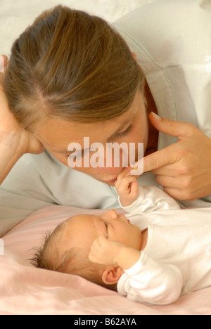 Mother and a newborn child in hospital - Stock Photo