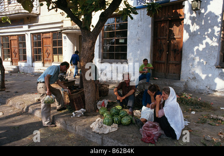Street scene with people selling watermelons in Tirana, Albania 1994 - Stock Photo