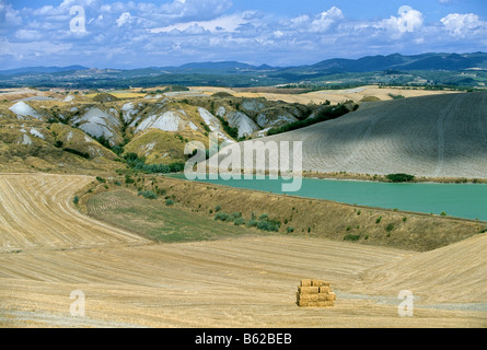 Artificial lake in an eroded landscape, Le Crete near Leonina, Siena Province, Tuscany, Italy, Europe - Stock Photo