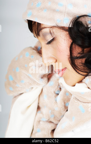 Young woman dressed in winter clothes - Stock Photo