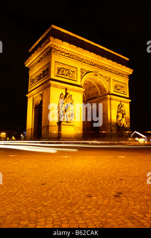 Arch de Triomphe floodlit at night, Paris, France, Europe - Stock Photo