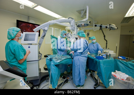Neurosurgeons removing a benign brain tumor, Reykjavik, Iceland - Stock Photo