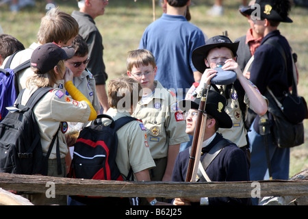 Boyscouts enjoying talking to a Union Soldier reenactor during a Civil War Reenactment at the old Wade House Greenbush - Stock Photo