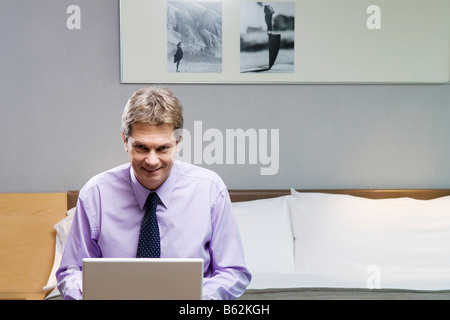 Portrait of a businessman working on a laptop - Stock Photo
