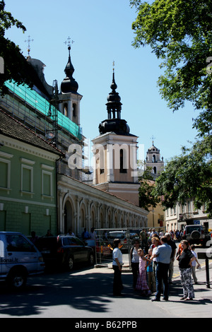 Group of tourists near The Church of St Michael, Vilnius, Lithuania - Stock Photo