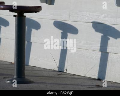 Stools and shadows at a cafe - Stock Photo