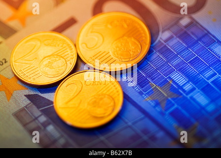 Close-up of European union coins with a five hundred euro banknote - Stock Photo