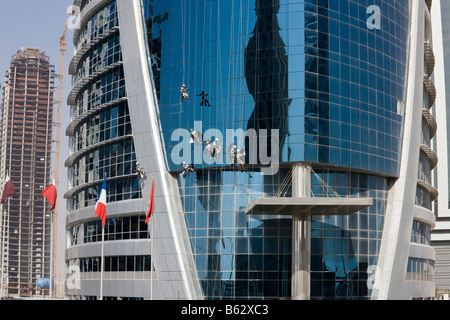 window cleaners on outside of Doha Tower Qatar - Stock Photo