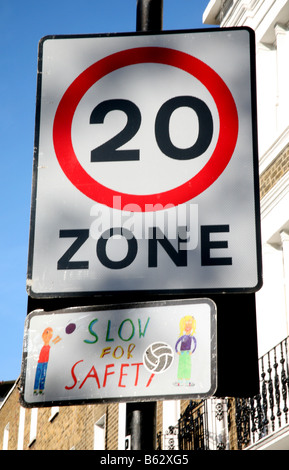 20 mph zone sign in London street - Stock Photo