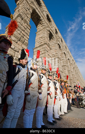 Men dressed up in old military costumes at the Roman Aqueduct in Segovia, Spain. - Stock Photo