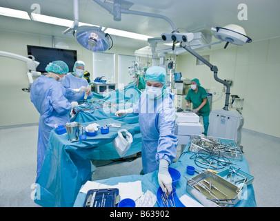 Neurosurgeons removing a benign brain tumor, Reykjavik, Iceland - Stock Photo