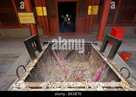Smoking incense sticks burned as offering in theYongHeGong lama temple in Beijing, China - Stock Photo
