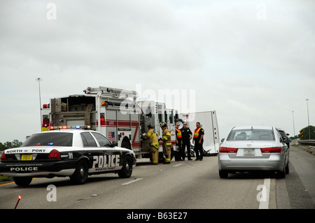 American police & fire truck at accident scene USA - Stock Photo