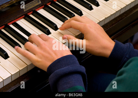 Girl s hands on piano keyboard - Stock Photo