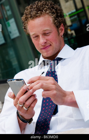 A young business executive works on his Phone - Stock Photo