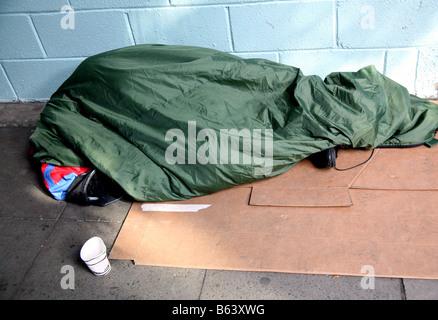 Homeless person under sleeping bag London - Stock Photo