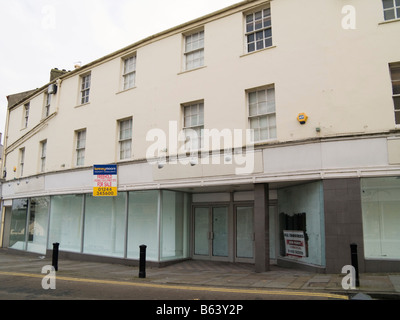 Bangor Gwynedd North Wales UK Large shop building closed and for sale in High Street windows whitewashed - Stock Photo