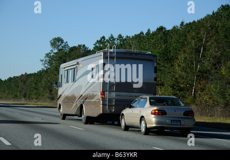 Mountain Aire RV southbound on Interstate 95 USA heading towards Florida America United States towing a Chevrolet - Stock Photo