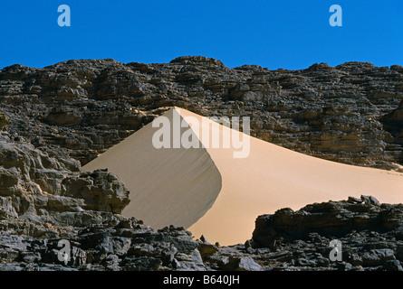 Algeria, near Djanet. Landscape. Sand dunes and rocks. Sahara Desert. - Stock Photo