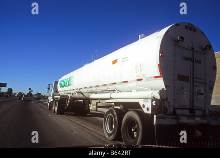 Compressed gas chemical truck drives on freeway. - Stock Photo