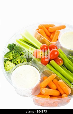 Party tray of fresh veggies and dip isolated on white with clipping path - Stock Photo