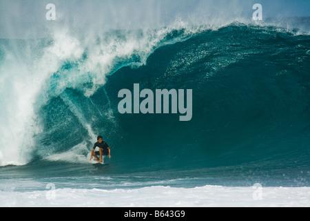 Surfer riding huge wave, Bonzai Pipeline, North Shore, Oahu, Hawaii Stock Photo