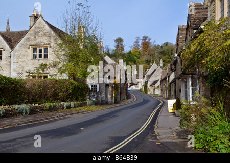 Picturesque village of Castle Combe in the Cotswolds, England taken on a fine autumn day, showing the main street. - Stock Photo