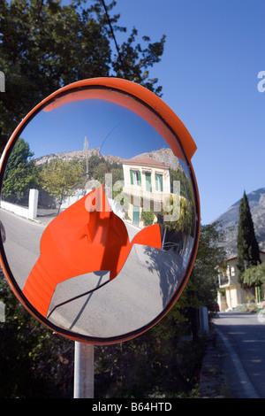 Reflections in broken convex mirror - Kefalonia, Greece - Stock Photo