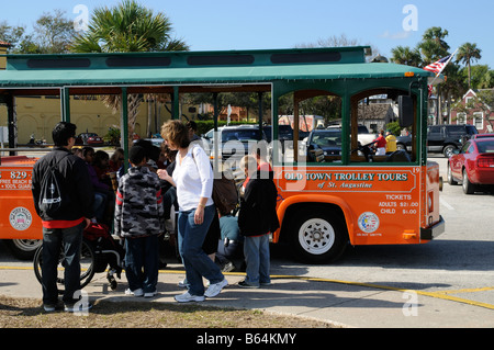 St Augustine Florida USA Old Town Trolley Tour Bus And A Group Of Schoolchildren Waiting To